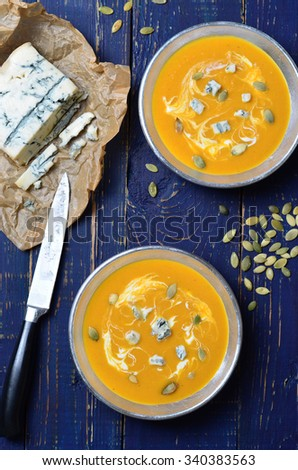 Pumpkin Soup with blue cheese and pumpkin seeds, selective focus - stock photo