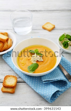 pumpkin soup with cheese, food closeup - stock photo