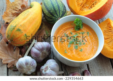 Pumpkin soup with fresh parsley in a bowl - stock photo