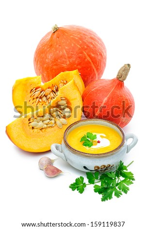 Pumpkin soup with fresh pumpkins  over white background - stock photo