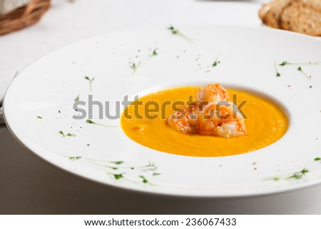 pumpkin soup with prawns - stock photo