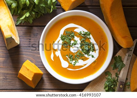 Pumpkin soup with the fresh pumpkin and parsley - stock photo