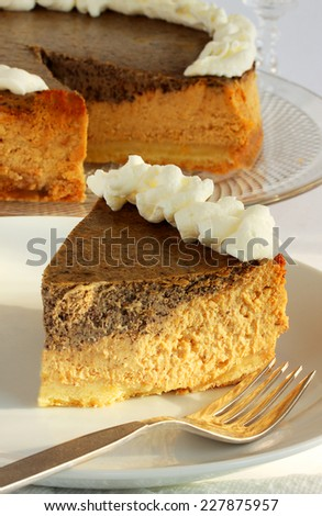Pumpkin spice cheesecake with a chocolate layer for Thanksgiving or Christmas - stock photo