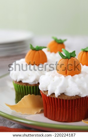 Pumpkin spice cupcakes with vanilla frosting - stock photo