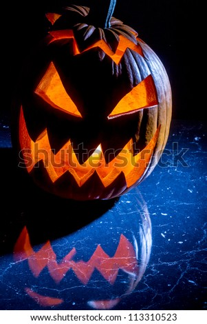 Pumpkin with candle lighted for halloween - stock photo