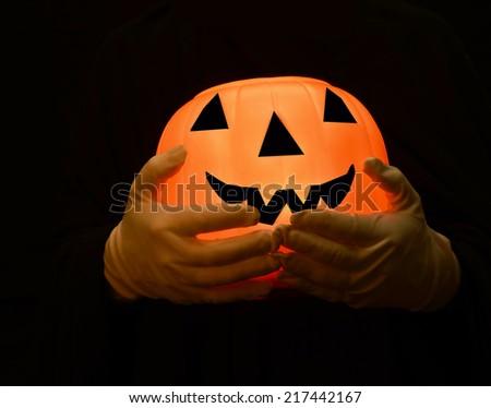 Pumpkin with orange glow/Halloween Scare/Hands holding a pumpkin - stock photo