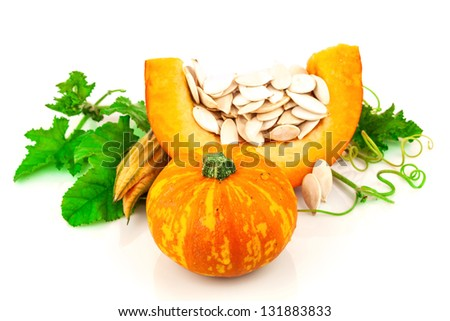 Pumpkin with pumpkin seeds isolated on white background - stock photo