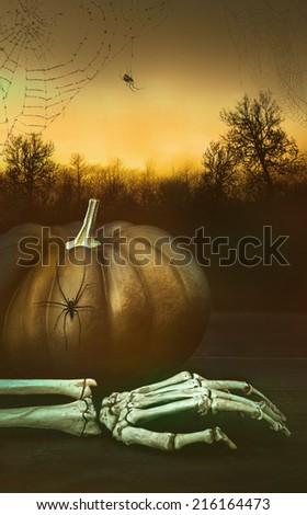 Pumpkin with skeleton hand and spider webs with night background - stock photo