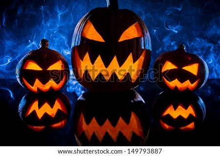 Pumpkins for Halloween on a blue background - stock photo