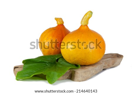 Pumpkins on a wooden plate. - stock photo