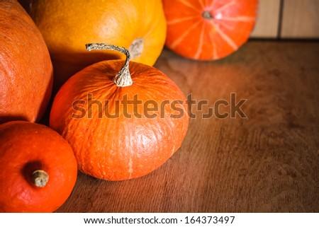 Pumpkins on grunge wooden backdrop, background table. Autumn, halloween, pumpkin - stock photo