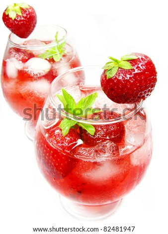 punch fruit liqueur cocktail drinks with strawberry and ice - stock photo