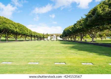 Punchbowl Cemetary or the  National Memorial Cemetery of the Pacific is visited by millions of tourist and island locals every year on the tropical island of Oahu in Honolulu, Hawaii, USA. - stock photo