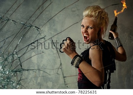 Punk girl behind broken glass - stock photo