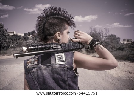 punk girl with his crest of hair on his head and his gun - stock photo