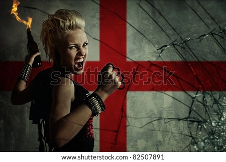 Punk girl with Molotov cockatail against England flag. - stock photo
