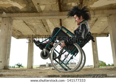 Punk in wheelchair - stock photo