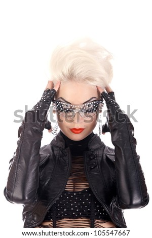 Punk rock girl with red lips and blond  big hair in black leather - stock photo