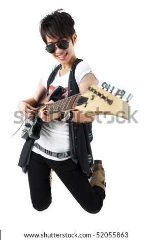 Punk Rockstar holding a guitar kneeling isolated in white - stock photo
