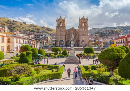 PUNO, PERU, MAY 5, 2014 - Plaza de Armas with the seventeenth-century Cathedral. - stock photo