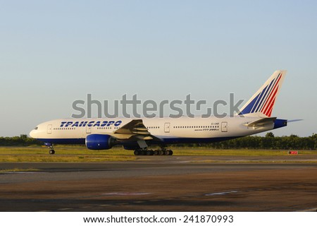 PUNTA CANA, DOMINICAN REPUBLIC - JANUARY 4: Transaero Airlines Boeing 777 taxing at Punta Cana Airport on January 4, 2015. The Dominican Republic is the most visited destination in the Caribbean  - stock photo