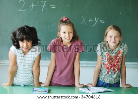 Pupil activities in the classroom at school - stock photo