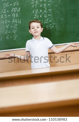 Pupil doesn't know the correct answer and throws up his hands - stock photo