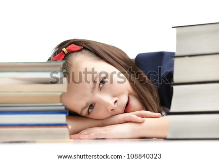 Pupil is yawning around the pile of books, isolated, white background - stock photo