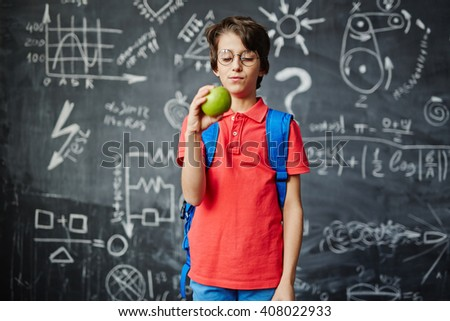 Pupil with apple - stock photo