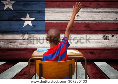 Pupil with the answer against composite image of usa national flag - stock photo
