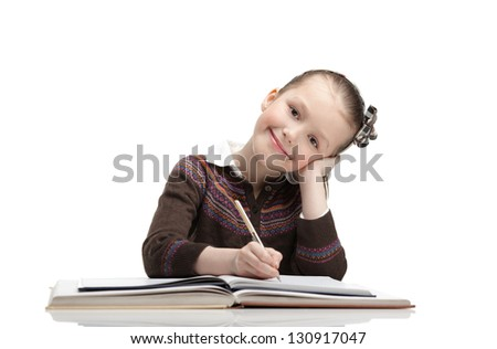Pupil writes something at the paper, isolated, white background - stock photo