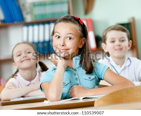 Pupils are happy to attend classes. They listen to every word of teacher - stock photo