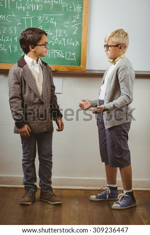 Pupils dressed up as teachers in a classroom in school - stock photo