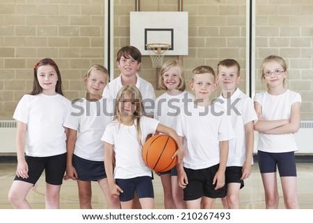 Pupils In Elementary School Basketball Team - stock photo