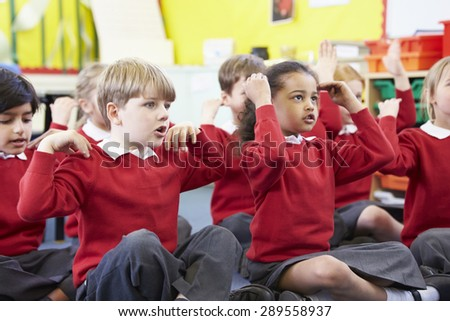 Pupils Perfoming Actions Whilst Singing Song - stock photo