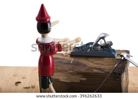 Puppet Pinocchio made of wood and then painted - stock photo