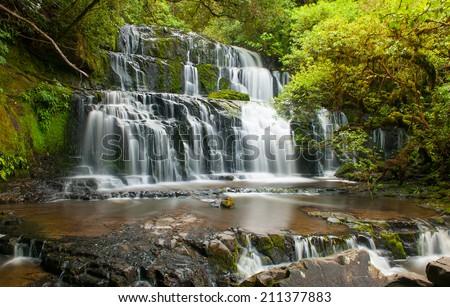 Purakaunui Falls is a beautiful small waterfall on the Catlins (South of the Southern island), New Zealand - stock photo