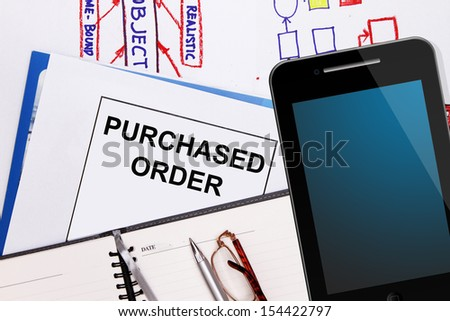 Purchased order , business graphs and business plan - stock photo