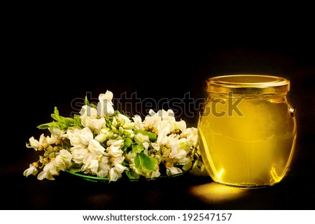 Pure acacia honey is very popular and coveted. - stock photo