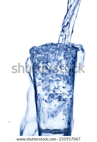 pure and clean water is filled into a glass. drinking water, water glass, glass, dehydration, dehydrate, dehydration in a teacup. - stock photo