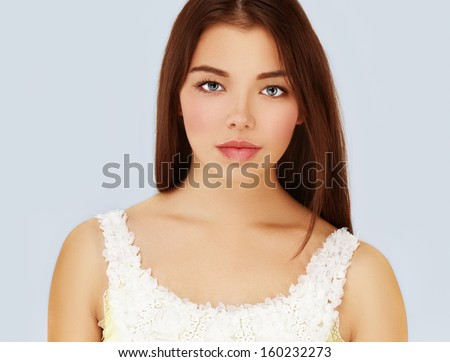 Pure Beauty.Blue background - stock photo