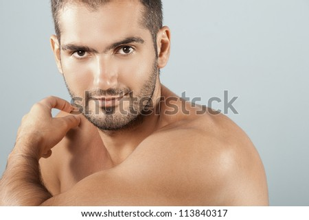 Pure beauty Man's Close up isolated on a Blue background.  Health care lifestyle concept. Studio shoot, Horizontal. - stock photo