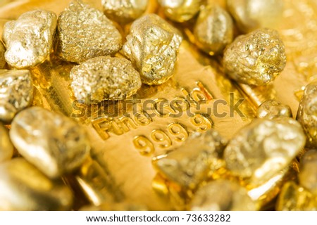 pure gold ingots and nuggets. - stock photo