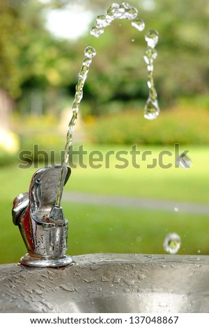 Pure water from faucets in park. - stock photo