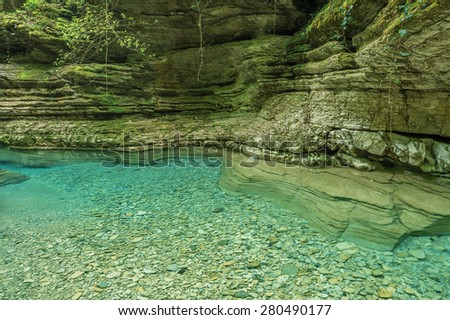 Pure water of the creek in the deep canyon. - stock photo