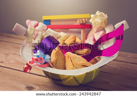 Purim holiday gifts with hamantaschen cookies and candy - stock photo