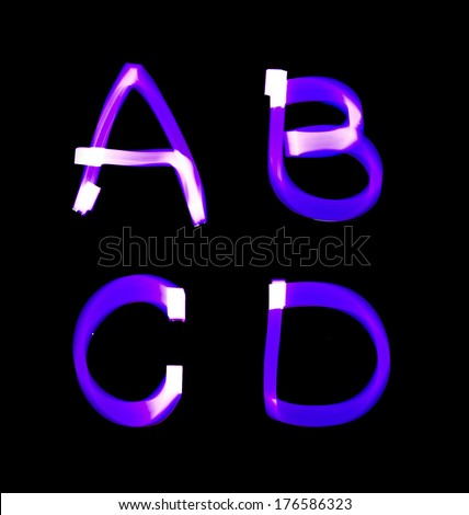 purple alphabet created with light (A, B, C, D) - stock photo