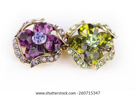purple and green brooch - stock photo