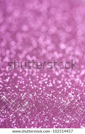 Purple and pink glitter with selective focus - stock photo