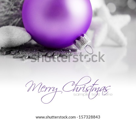 Purple and silver xmas decoration. Christmas card with pace for text. - stock photo